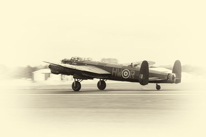The mighty Lancaster Bomber takes to the skies on a nostalgic flyby. Air Vehicle Airforce Airplane History Lancaster Bomber Military Nostalgia Raf Sepia Sky Take Off Transportation