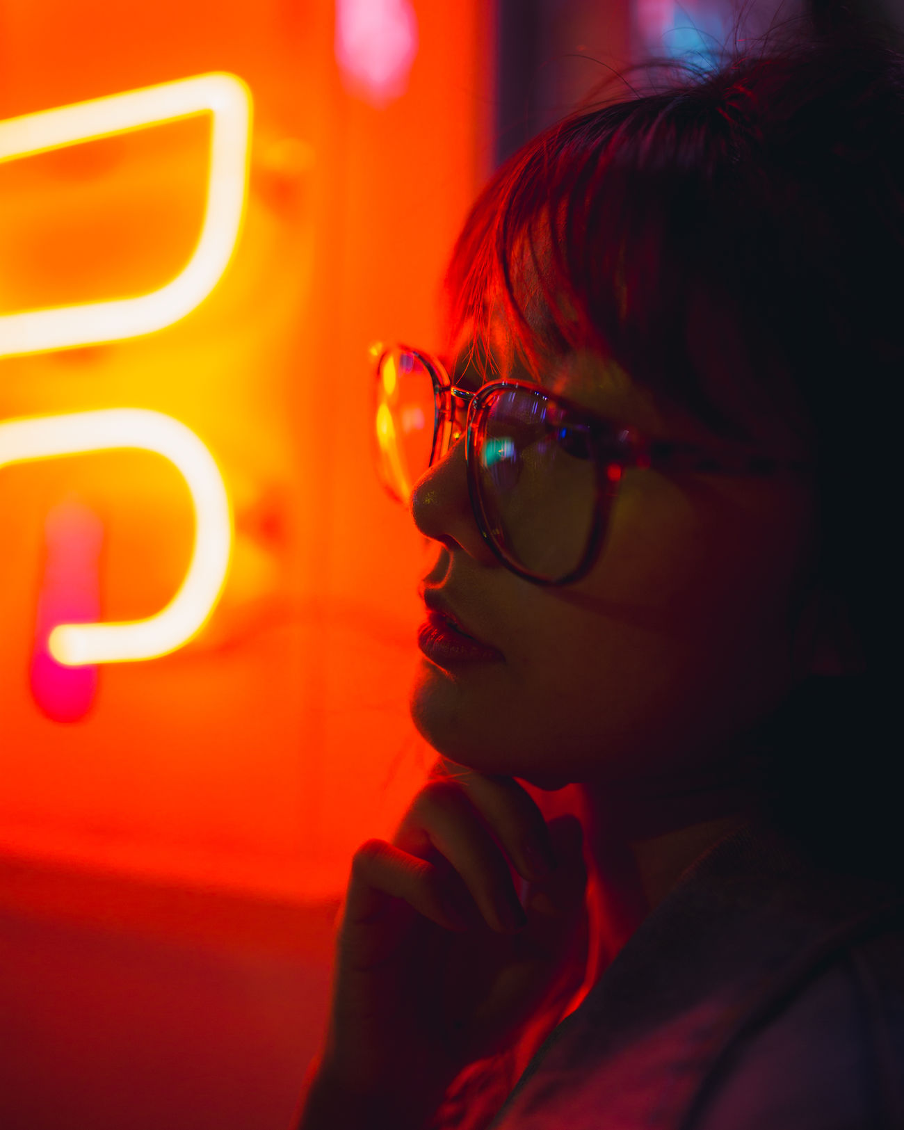 Finders' Keepers Neon Lights Neon Fire Light Night Lights Beautiful People Portrait Of A Girl Portrait Of A Woman Portrait Photography Real People Light Collection Orange Red Technology Close-up Eyeglasses