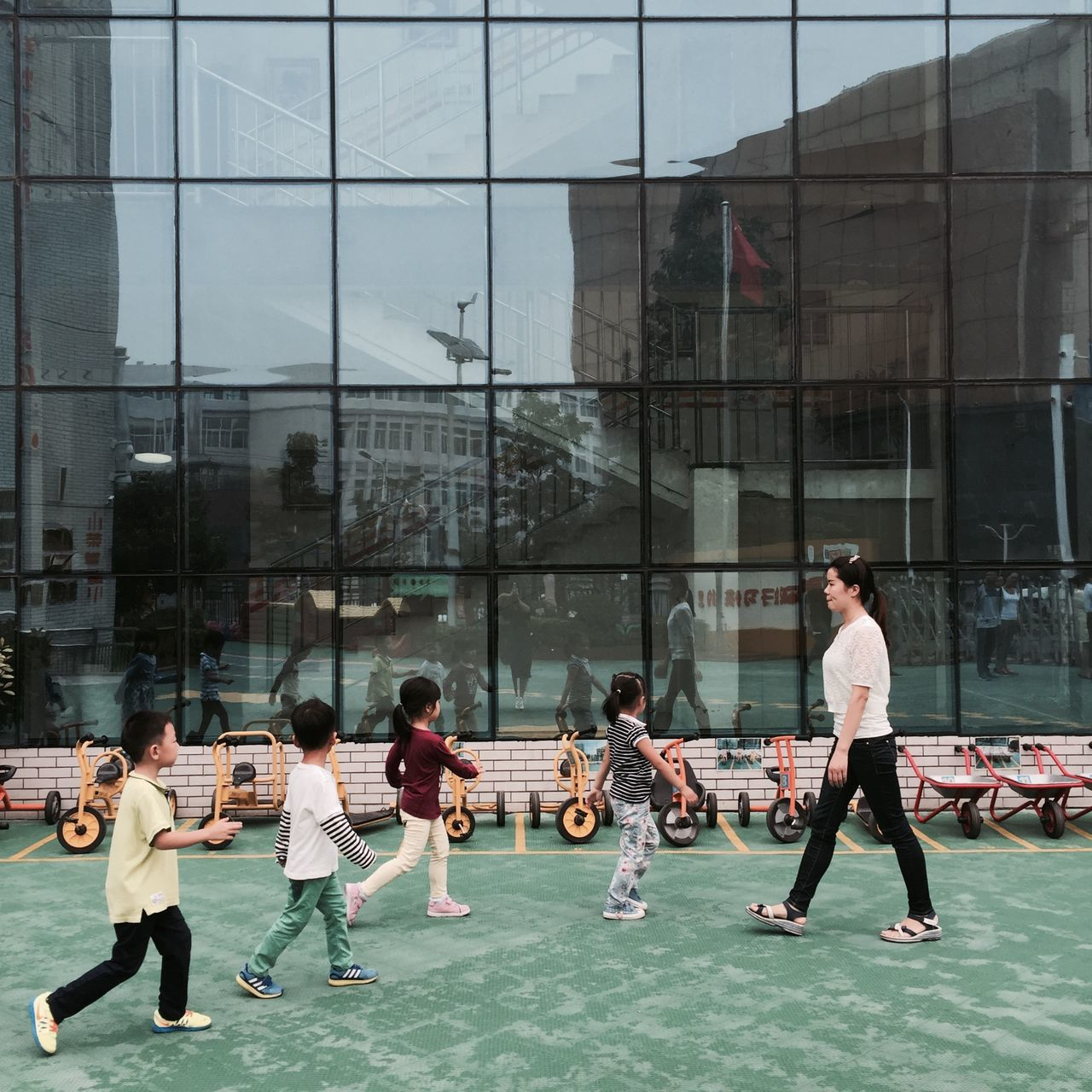 medium group of people, playing, real people, full length, architecture, togetherness, day, men, building exterior, outdoors, friendship, people, adult