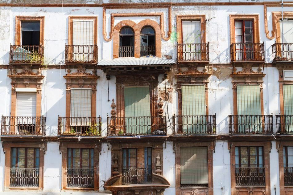 Apartments in Seville Building Exterior Architecture Built Structure Residential Building Window Building Outdoors No People Day Decoration Buildingstyles SPAIN Home Is Where The Art Is Home Home Sweet Home Lifestyles Architectural Feature Apartment Façade Front View Buildings White Living Architecture Spanish