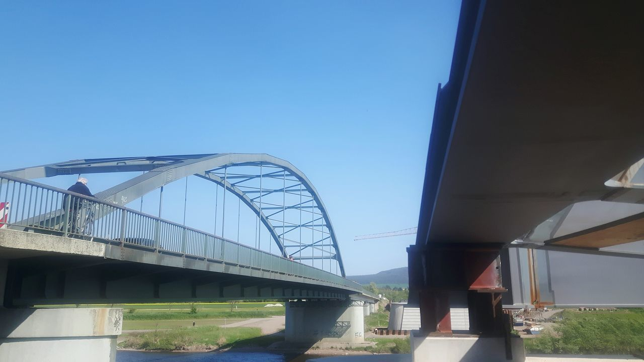Bridge - Man Made Structure Day Built Structure Architecture Sky No People Golf Club Outdoors Bridge Construction Architecture Beauty In Nature Weserbergland Summer Bridge Collection Diminishing Perspective Clear Sky Bridge View Blue Nature Beach Water Hessisch Oldendorf Fühlen Weserbrücke