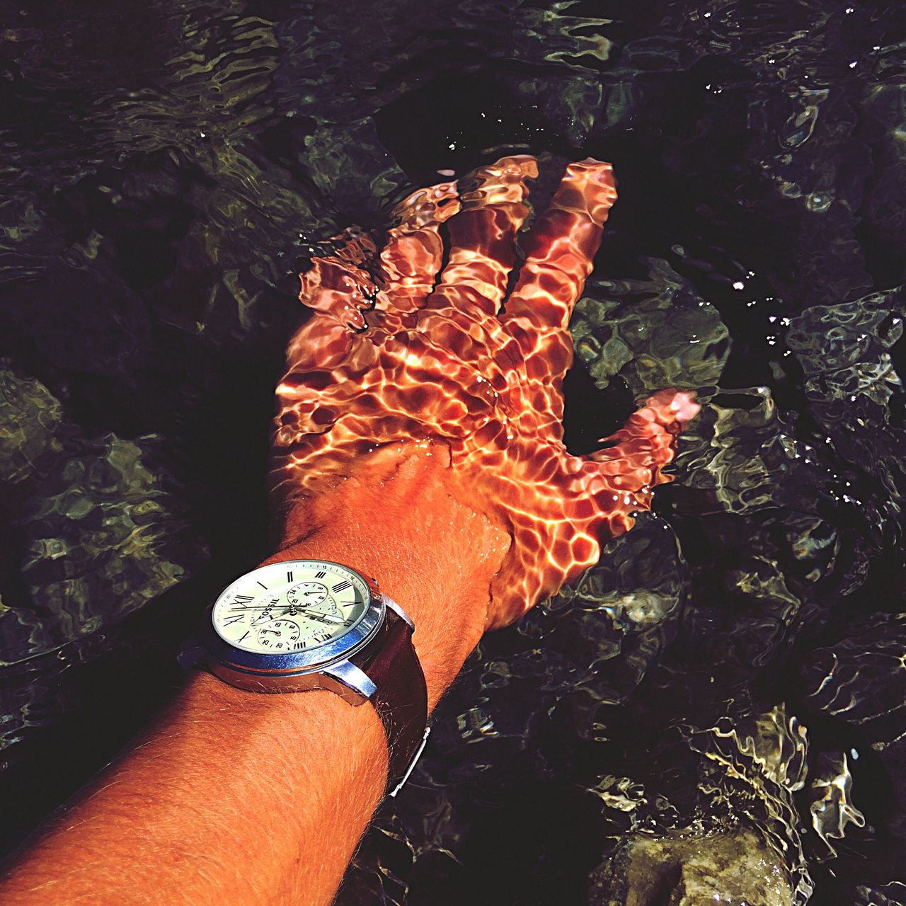 human body part, one person, real people, human hand, high angle view, wristwatch, personal perspective, human leg, lifestyles, low section, water, outdoors, men, close-up, day, nature, time, one man only, people