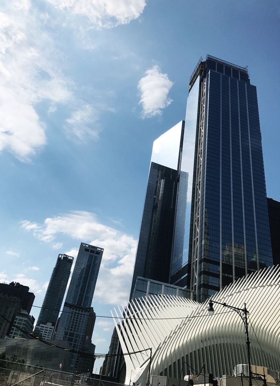 architecture, skyscraper, built structure, tall - high, building exterior, low angle view, modern, sky, tower, day, city, cloud - sky, no people, travel destinations, outdoors, tall, growth