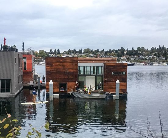 Architecture Built Structure Floating House Waterfront Reflection Urban Photography Urban Exploration Construction Modern Corten Rust i like the supervisor on the standup paddle board. They had a nice, calm morning to over the new house into position.