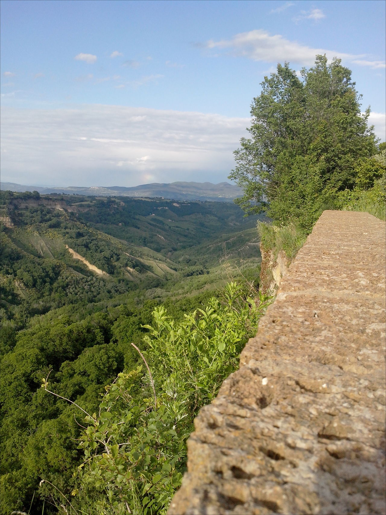 Beauty In Nature Blue Sky Civita Di Bagnoregio Cloudy Sky Grass Green Color Horizon Over Land Landscape Mountain The City That Is Dying Tree Tuff Tufo Valley View World Monuments Watch