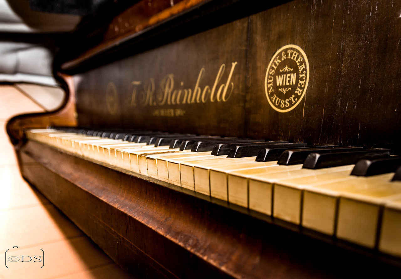 musical instrument, music, piano, text, wood - material, piano key, indoors, no people, close-up, day