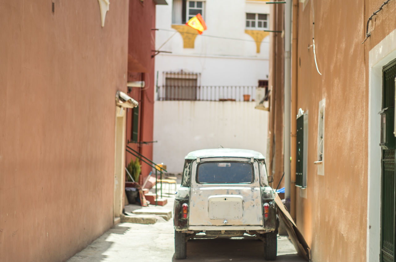 Building Car Day Mode Of Transport Narrow Narrow Street Parked Parking Small Car
