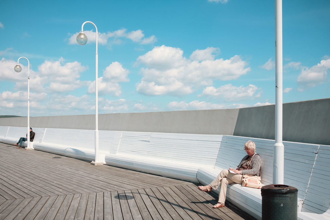 Bench Cloudscape Molo Poland Retired Sopot, Poland Street lamp Urban geometry Visual Stories blue sky cloud - sky clouds dockside lamppost old woman outdoors polish reading & relaxing reading a book real people Sitting sky sopot streetphotography woman portrait