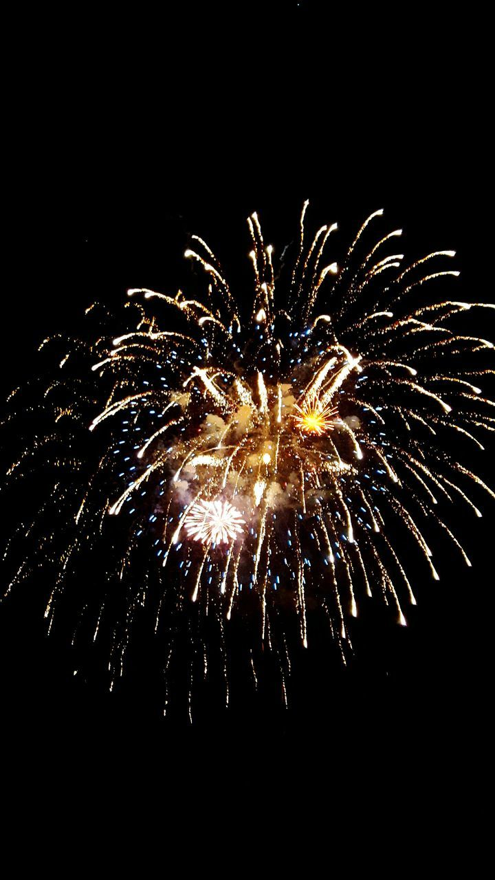 firework display, firework - man made object, night, sparks, long exposure, celebration, exploding, arts culture and entertainment, motion, glowing, illuminated, event, blurred motion, low angle view, firework, no people, sparkler, sky, outdoors, multi colored, black background