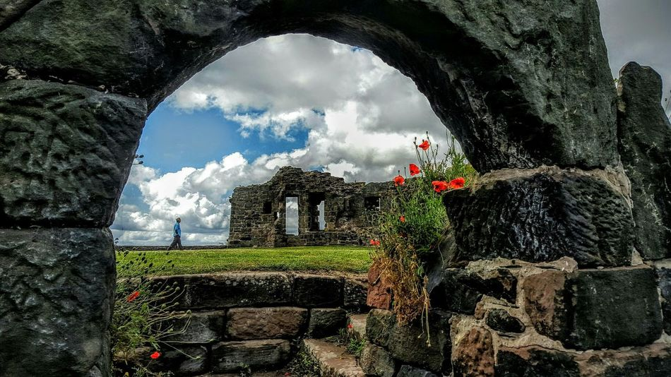Medieval Architecture Castle Ruins Archway Poppies  Halton Castle Runcorn Grass Clouds And Sky Man