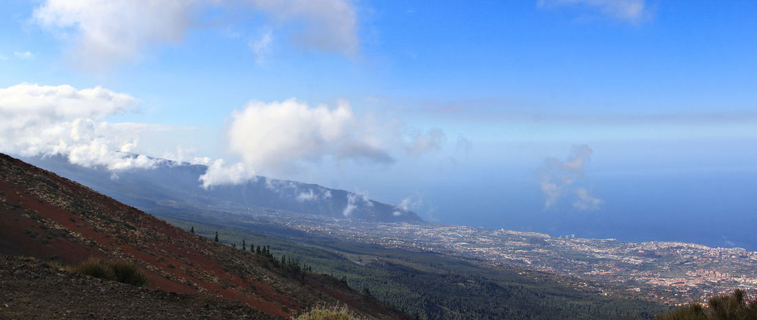 Beauty In Nature Clouds And Sky Day La Orotava Y Su Teide Landscape Mountain Nature No People Outdoors Panorama Panoramic Photography Puerto De La Cruz Scenics Sky Smoke - Physical Structure Tenerife Tranquility Tree View From Above