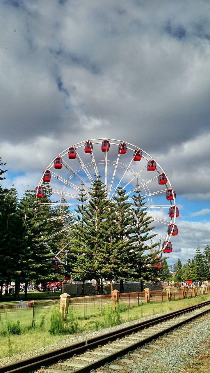 amusement park, sky, cloud - sky, arts culture and entertainment, tree, ferris wheel, day, outdoors, amusement park ride, no people, nature