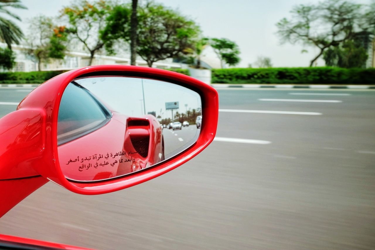 Speeding reflection Red Tree No People Day Outdoors Close-up Supercar Wheels Auto Car Ferrari Mirror Reflection Highway Speed Ride