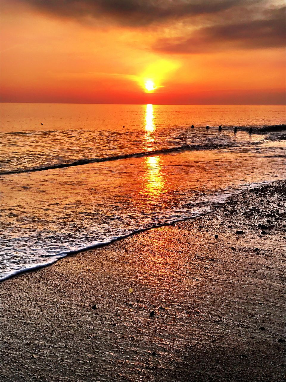 sunset, sea, beach, beauty in nature, scenics, orange color, water, nature, horizon over water, sun, tranquil scene, tranquility, sky, idyllic, sand, reflection, no people, outdoors, wave, sunlight, cloud - sky
