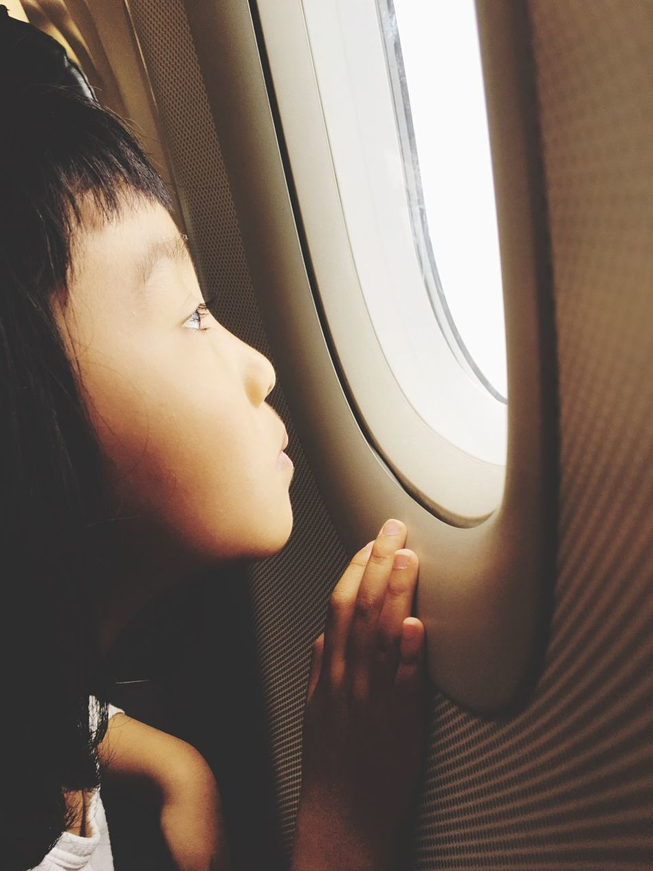 IPhoneography Iphonephotography IPhone Photography Child Window Airplane Flying Vehicle Interior Transportation Journey Vehicle Seat Mode Of Transport Passenger Indoors  One Person Travel Real People Looking Through Window Side View Sitting Air Vehicle Young Adult Young Women Lifestyles Day
