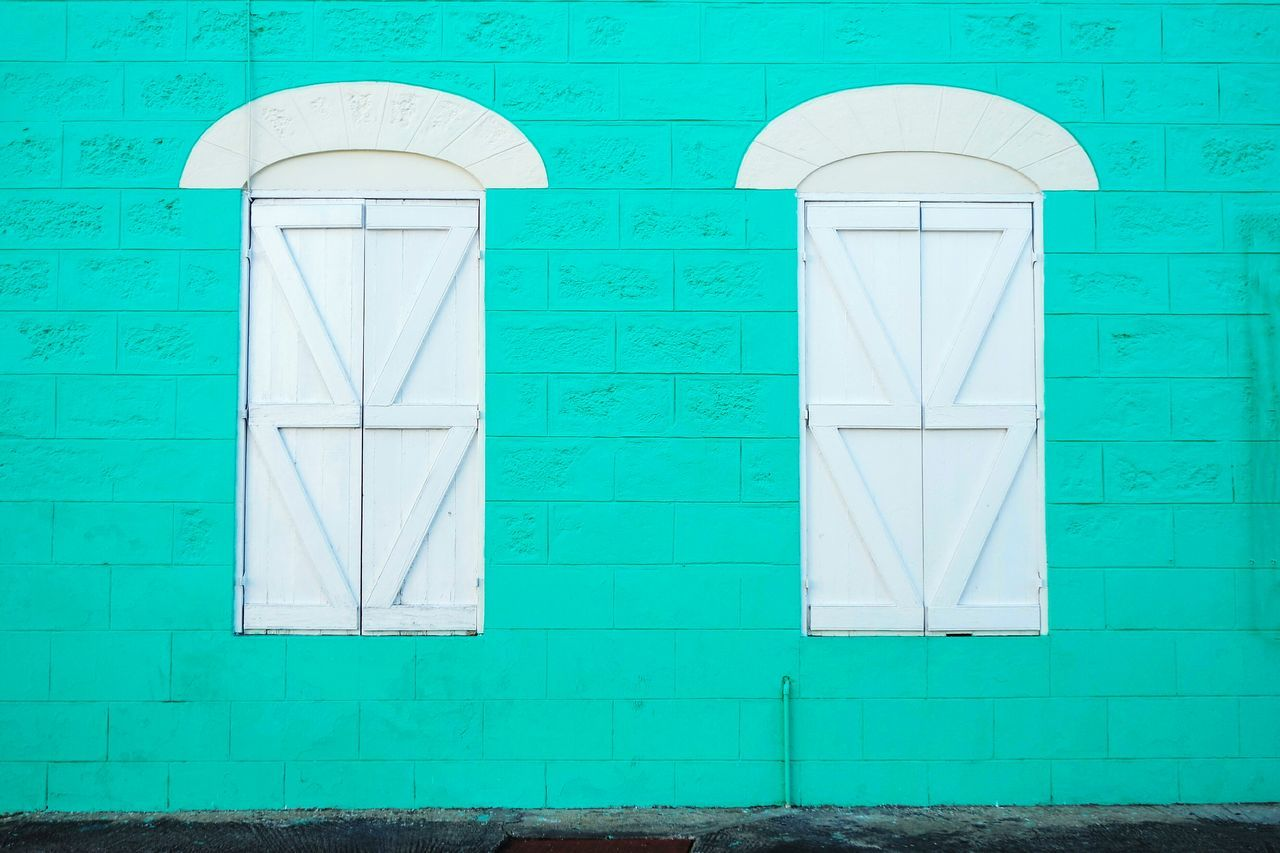 Lieblingsteil two windows in Barbados No People Built Structure Architecture Building Exterior Close-up Day Outdoors Architecture Open Edit Eye4photography  EyeEm Best Shots Travel Destinations Fresh 3 Low Angle View City Streetphoto_color Uniqueness Window Windows Pastel Colors Minimalist Architecture