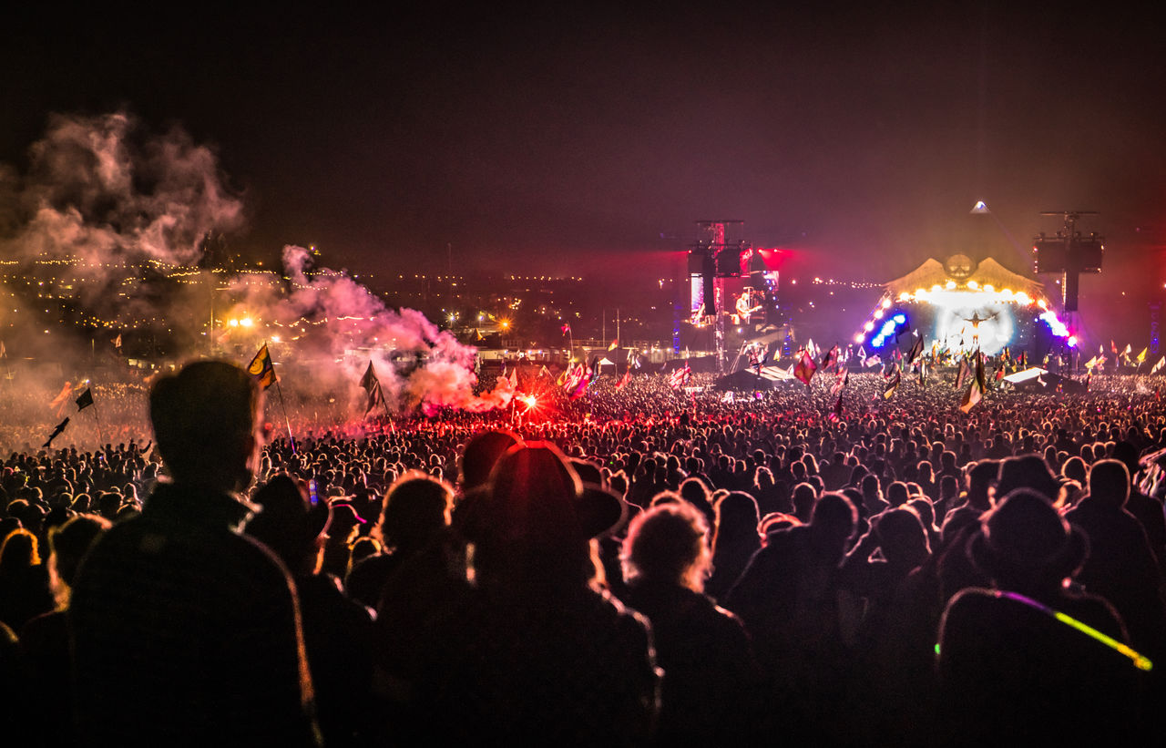 Pyramid stage and flare, The Who concert, Glastonbury 2015, United Kingdom Arts Culture And Entertainment Celebration Concert Crowd England TakeoverMusic Fans Festival Festival Season Flare Glastonbury Illuminated Large Group Of People Leisure Activity Music Music Festival Night Nightlife Performance Popular Music Concert Pyramid Stage - Performance Space Stage Light Togetherness Youth Culture