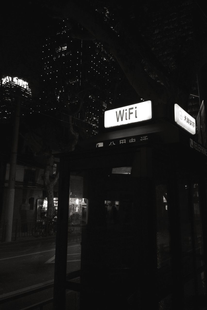 text, western script, communication, illuminated, guidance, direction, night, built structure, building exterior, outdoors, one way, no people, architecture, road sign