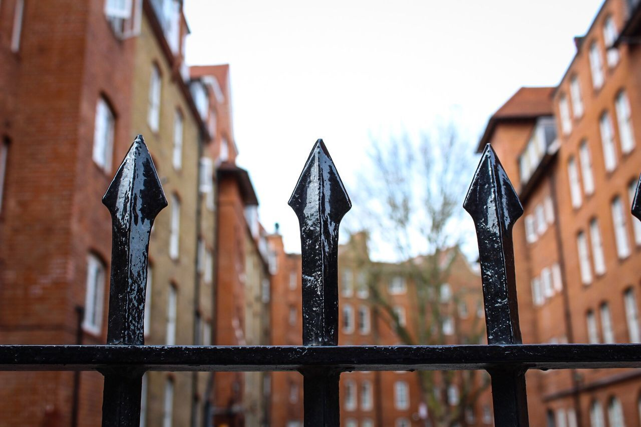 Focus On Foreground Fence Wood - Material No People Outdoors Close-up Day Picket Fence Built Structure Architecture Sky London Streetphotography Residential Building Dwelling Flats Windows Railing Metal Metalwork
