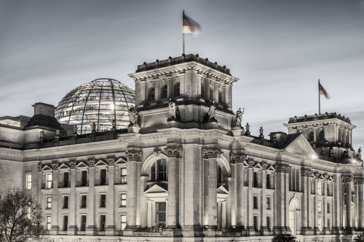 Back of Reichstag building illuminated at night in Berlin, Germany Architecture Back Of Building Berlin Building Exterior Built Structure City Color Image Flag German Flag Germany🇩🇪 Government History Horizontal Illuminated Night No People Outdoors Part Of Building Photography Politics Politics And Government Reichstag Building Berlin Sky Travel Travel Destinations