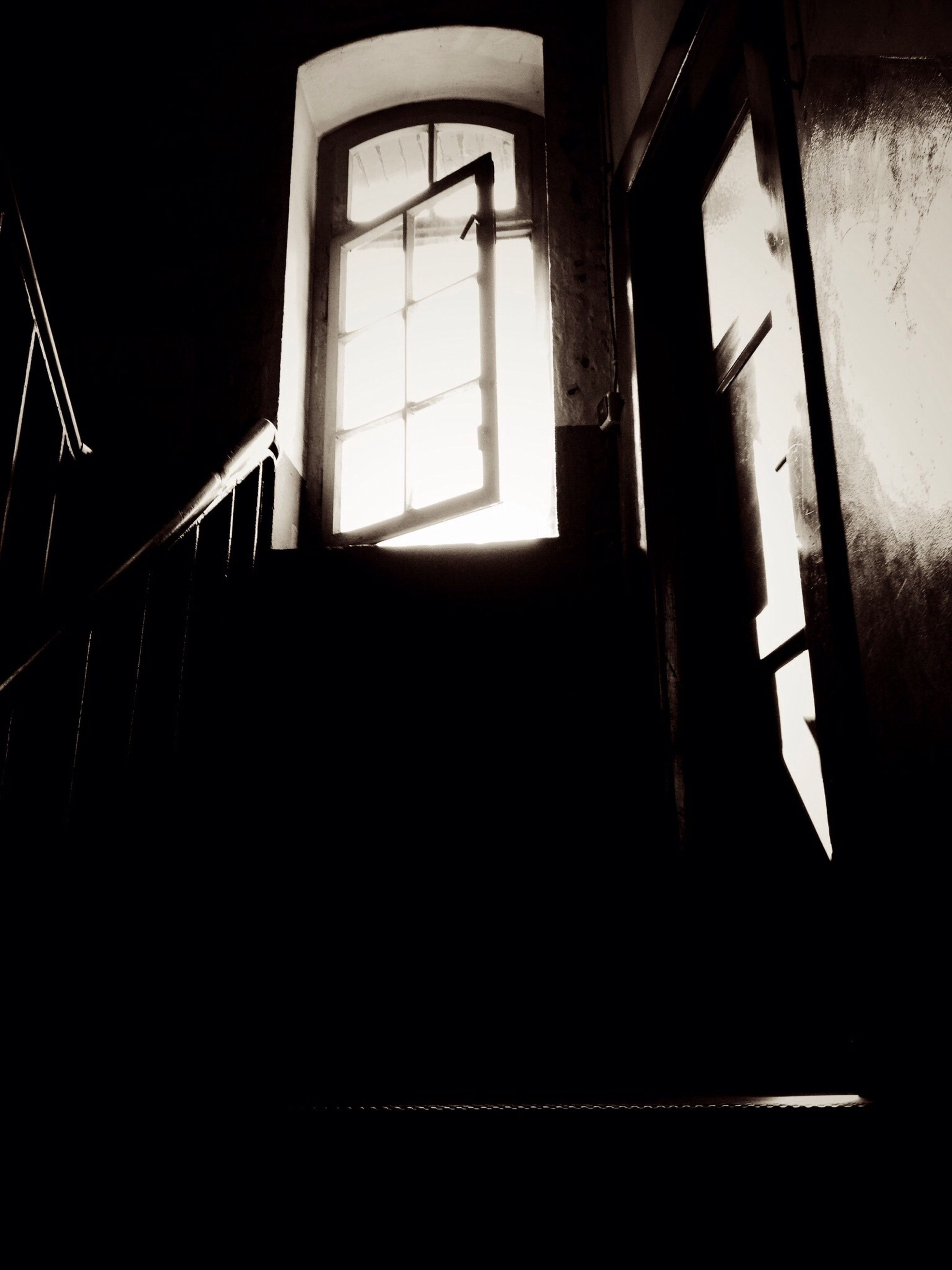 indoors, window, architecture, built structure, empty, sunlight, dark, absence, interior, door, house, glass - material, home interior, abandoned, transparent, no people, day, railing, shadow, open