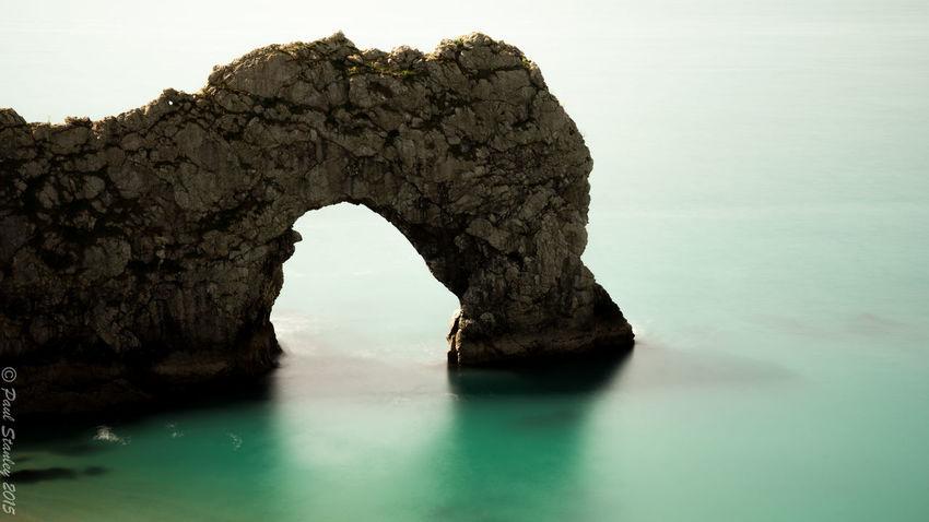 Durdle Door Rocks Rocks And Water Long Exposure Green Blue Water Beach Arch