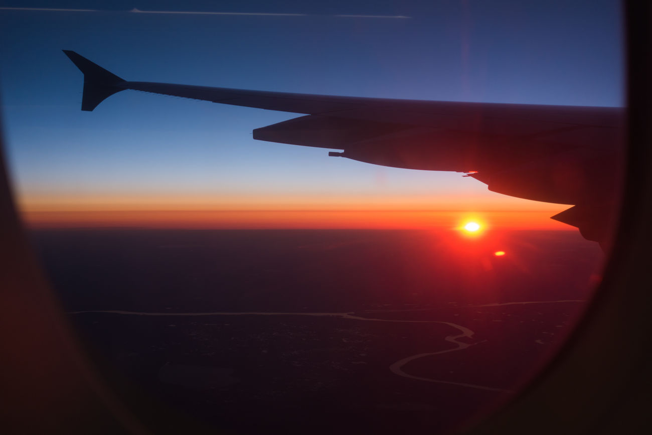 Air Vehicle Aircraft Wing Airplane Airplane Wing Beauty In Nature Day Flying Journey Mode Of Transport Morning Morning Light Nature No People Outdoors Scenics Silhouette Sky Sun Sunrise Sunset Transportation Travel