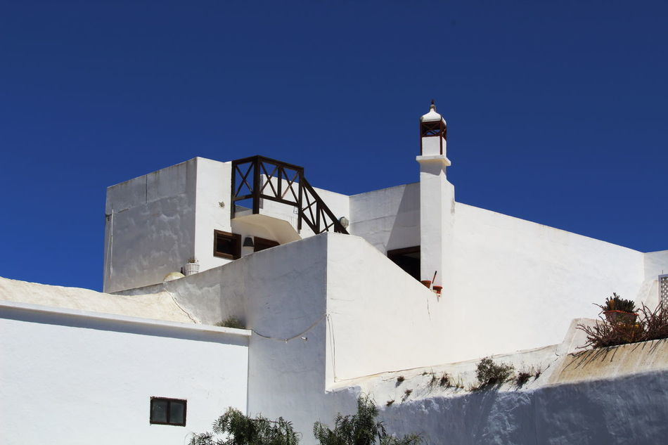 Architecture Architecture Of Canary Islans Blue Building Exterior Built Structure Clear Sky Day Lanzarote Architecture Lanzarote-Canarias Low Angle View Nature No People Océan Atlantique Outdoors Photo Art Place Of Worship Sky Spain Islands Spirituality Street Photography Sunlight White Building Whitewashed