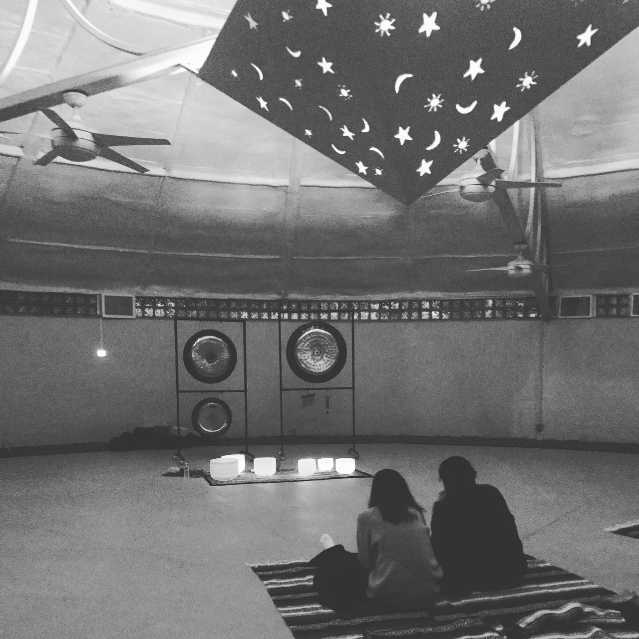 Powerful. Soundbath // Two People Indoors  Men Sitting Real People Lifestyles Illuminated Togetherness Day People Adult