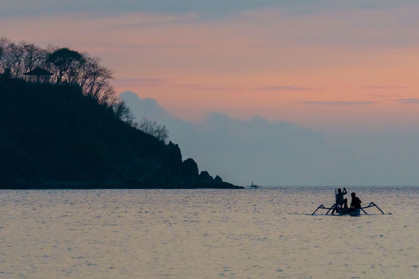 Traditional fisherman during majestic sunset in Lombok, Indonesia Bali, Indonesia Fisherman Lombok-Indonesia Rinjani National Park Rural Scenes Sunset Silhouettes Sunset_collection Tranquil Scene