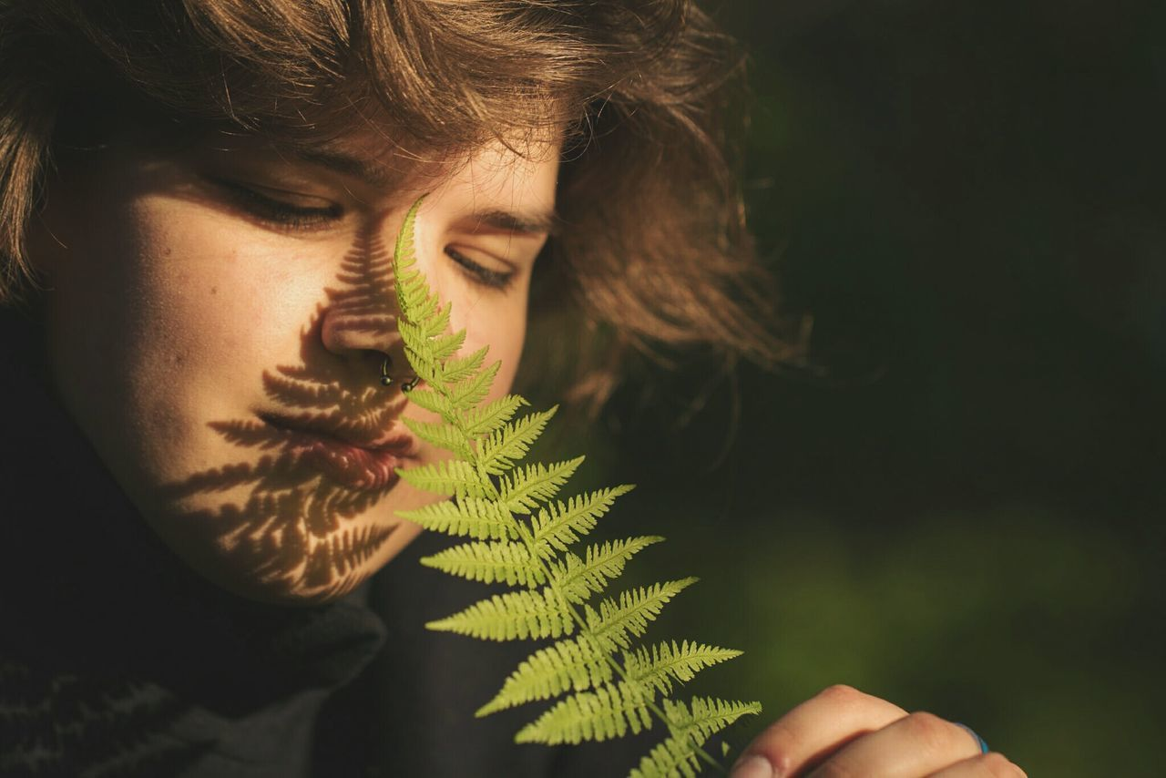~ 🌿😄 ~ Adult Close-up Green Color One Person Beauty Portrait Headshot Outdoors Young Women Day Human Hand People Human Body Part Adults Only Young Adult Only Women Happiness Light And Shadow Getting Inspired The Portraitist - 2017 EyeEm Awards Smiling Fern Leaves Ferns Lifestyles Live For The Story
