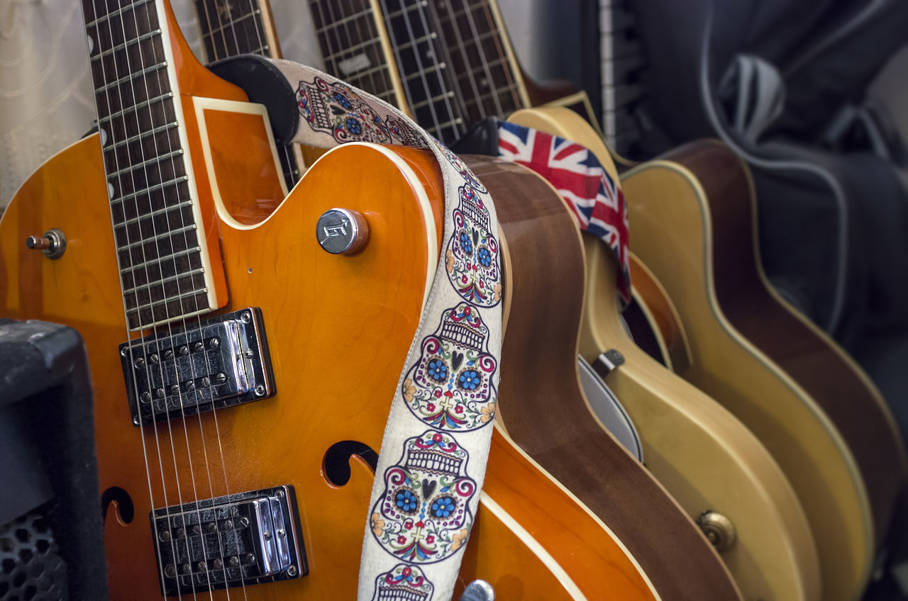 Close-up on a set of used guitars Arts Culture And Entertainment Close-up Electric Guitar Fretboard Guitar Instruments Messy Music Musical Instrument Musical Instrument String No People Orange Color Rock N Roll Skull