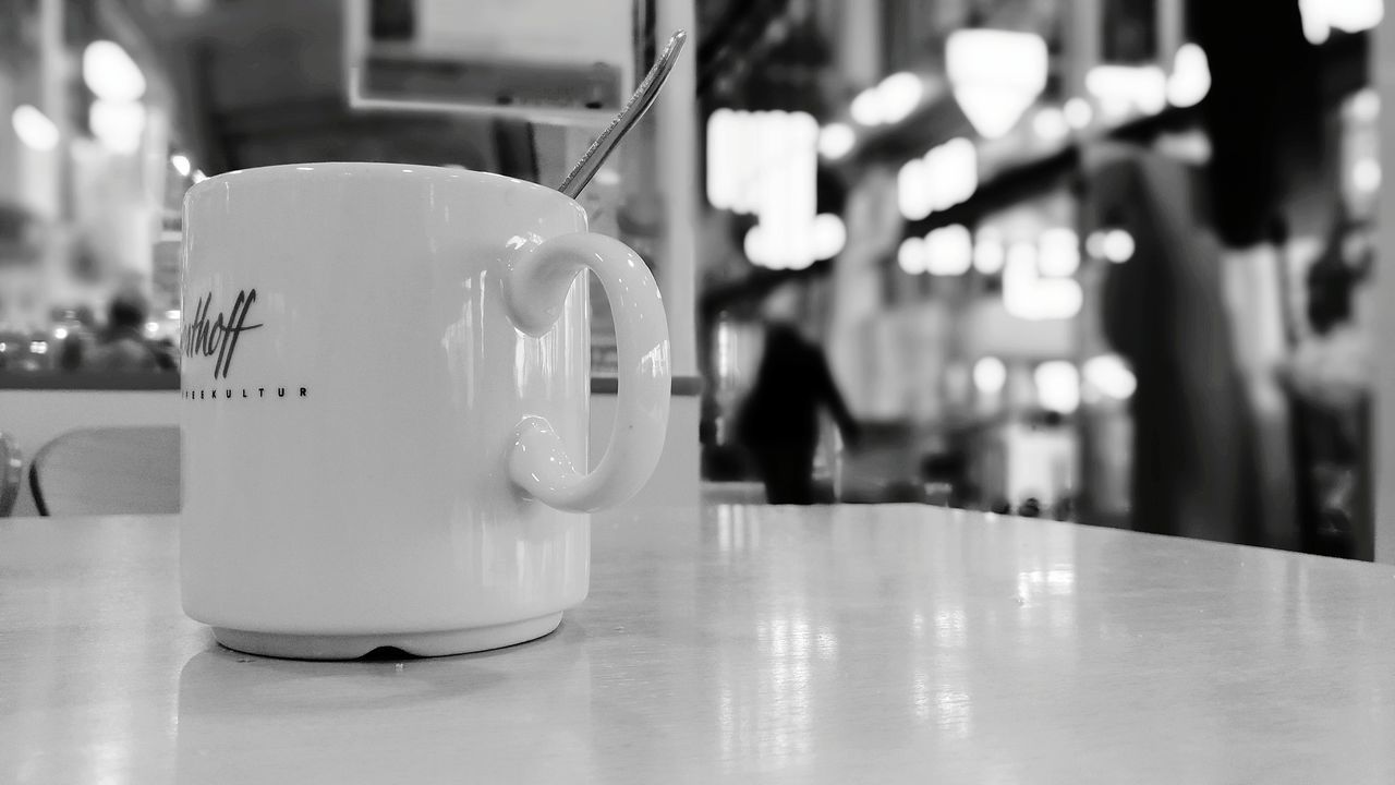 indoors, focus on foreground, table, close-up, no people, cafe, day