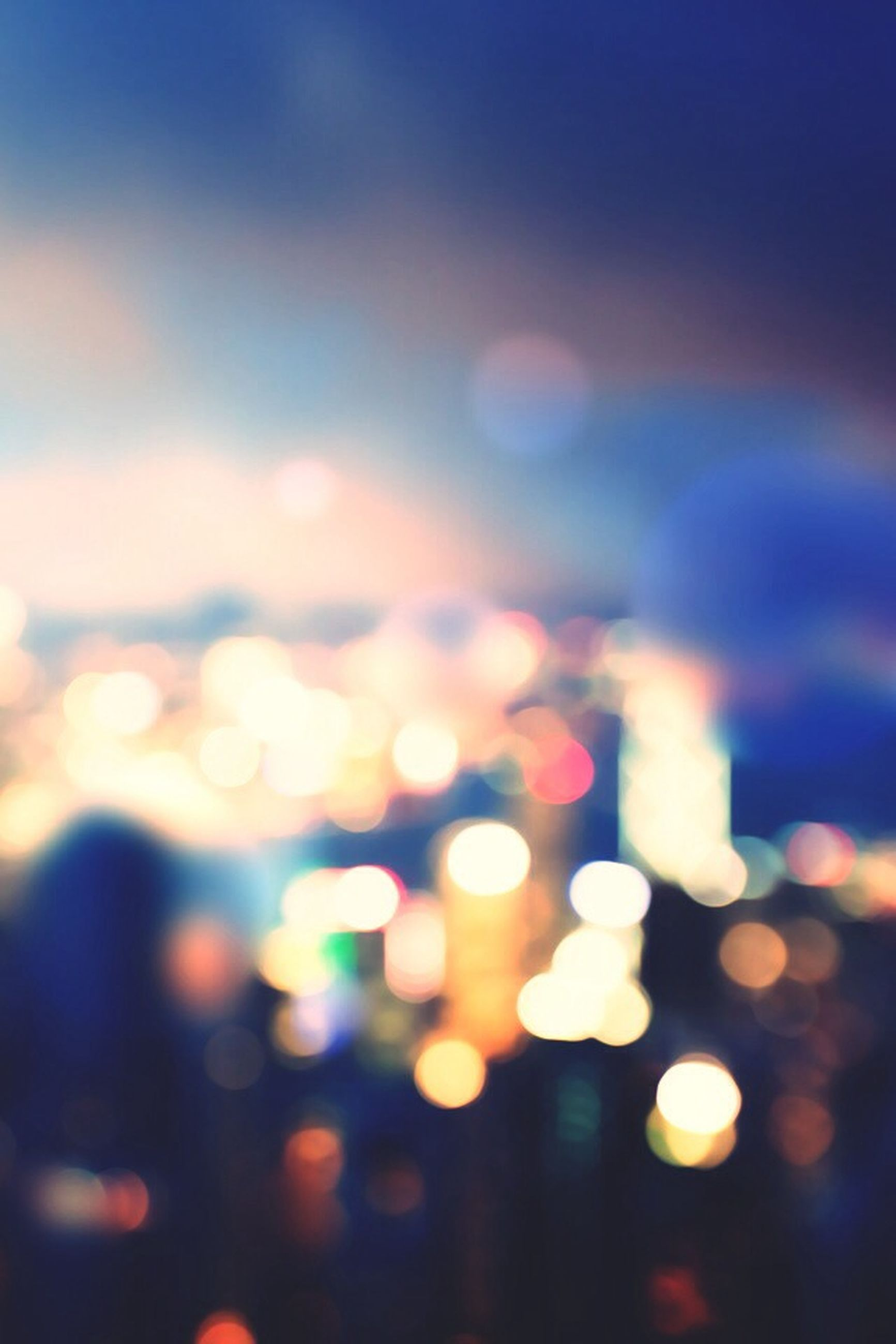 illuminated, defocused, multi colored, night, sky, city, light - natural phenomenon, lens flare, selective focus, focus on foreground, no people, outdoors, dusk, lighting equipment, glowing, blue, light, sunset, close-up, abstract