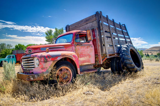 Abandoned Bad Condition Blue Damaged Day Deterioration Dirt Dirt Road Discarded Junkyard Land Vehicle Obsolete Old Outdoors Poverty Run-down Rusty Sky Stationary The Past Transportation Tru Weathered Worn Out Wreck