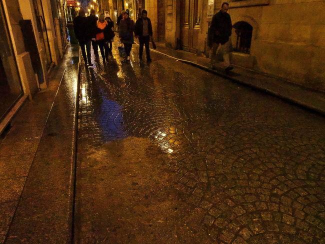 Walking on cobblestone Cobblestone Diminishing Perspective Men Rainy Day Reflections Street Street Photography Urban Walking