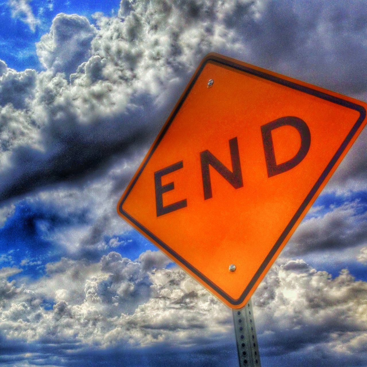 cloud - sky, sky, low angle view, communication, outdoors, no people, day, road sign, close-up