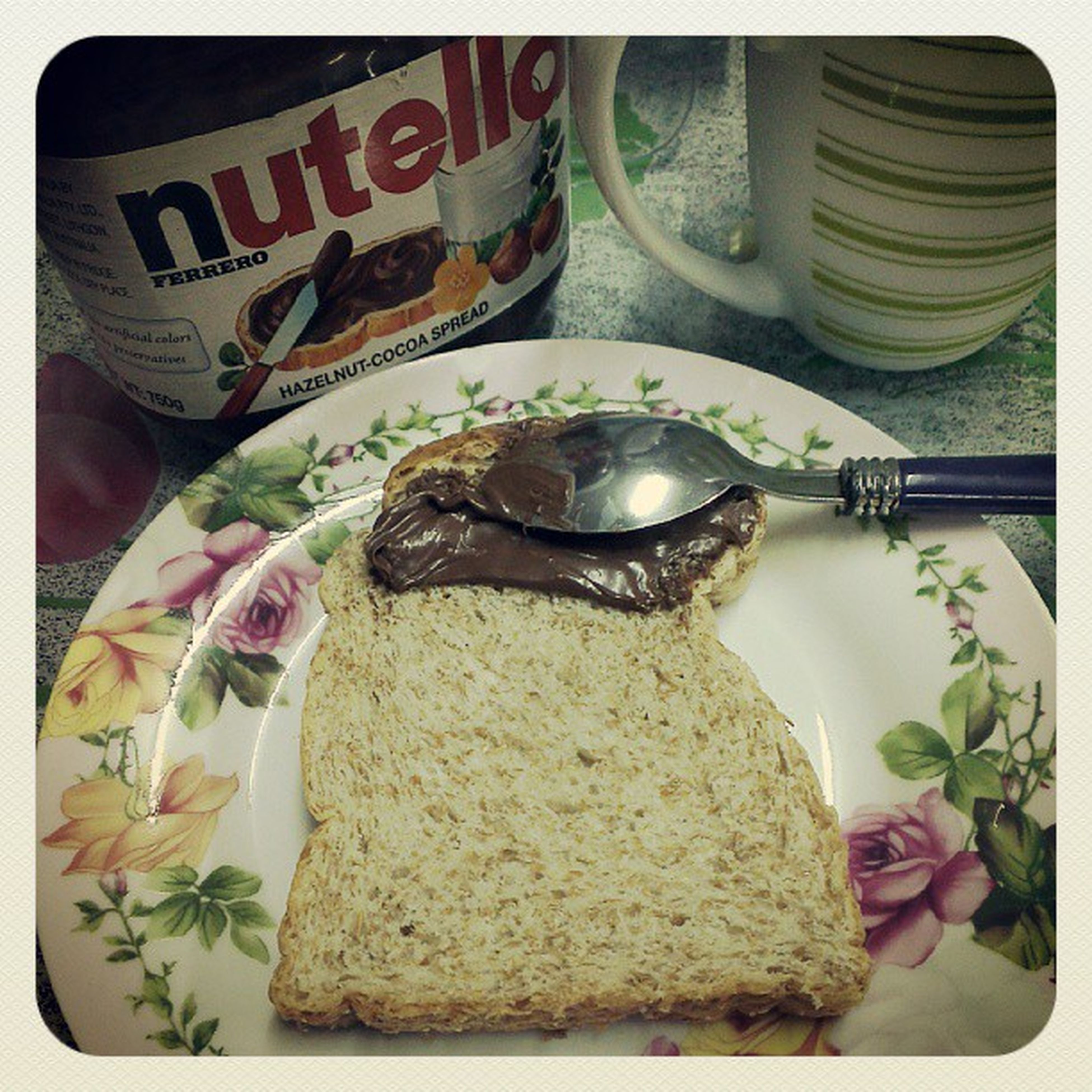 What better, after a huge plate of rice n'chicken.. Nutella on Wholemealbread Sahur  Eat yo!