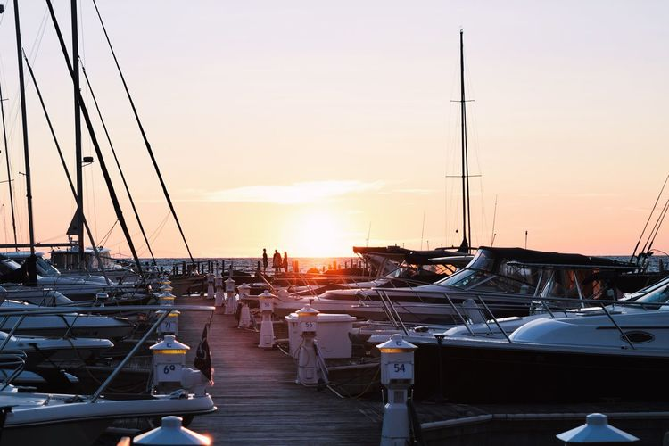 Sunset over the marina. Sunset Nautical Vessel Transportation Sea Sky Mode Of Transport Moored Outdoors Chair Mast Sun Clear Sky Water No People Nature Scenics Sailboat Harbor Yacht Beauty In Nature EyeEm Best Shots EyeEmNewHere First Eyeem Photo
