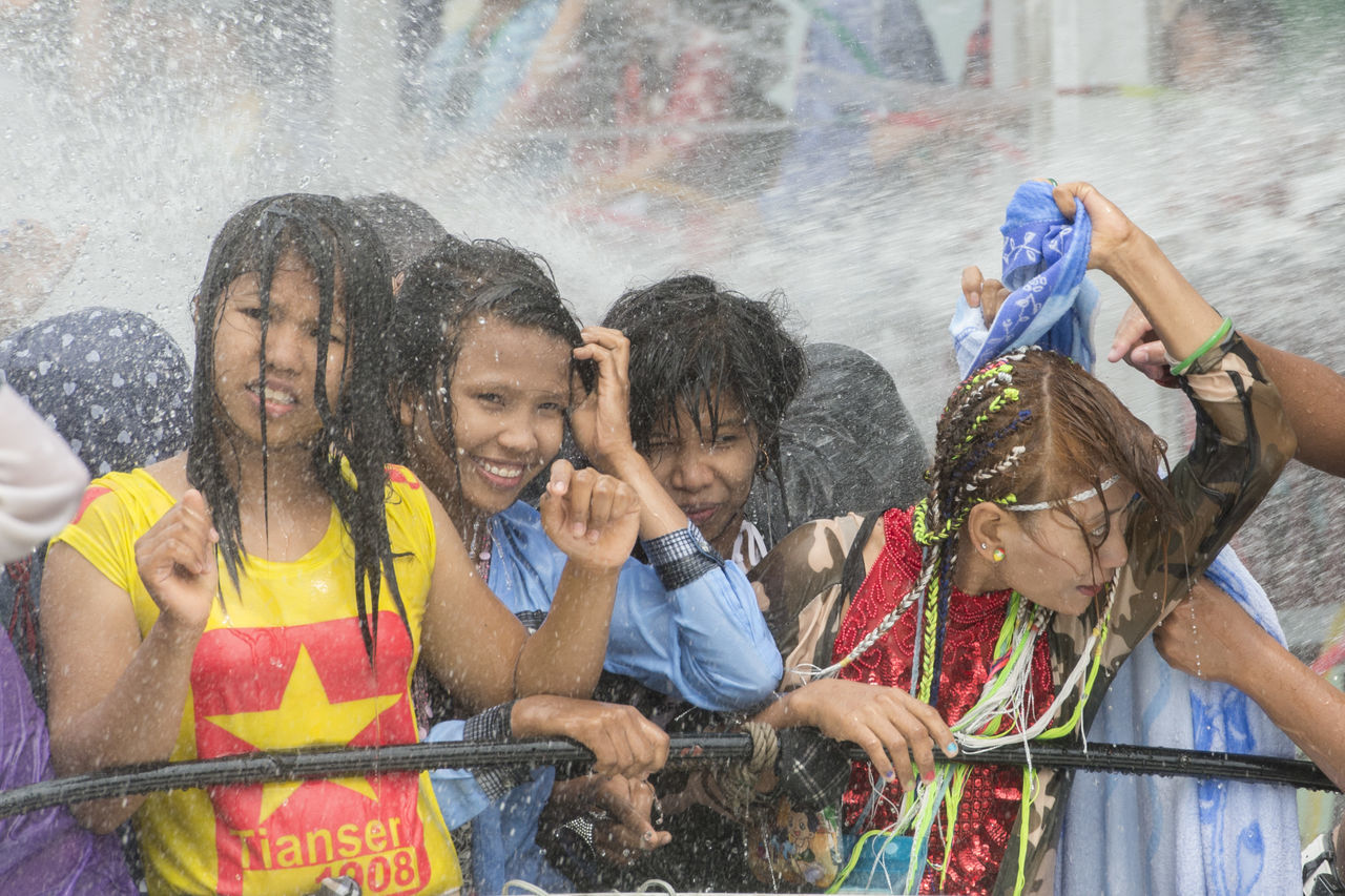 fun, boys, motion, water, spraying, outdoors, child, girls, enjoyment, happiness, day, togetherness, leisure activity, childhood, real people, multi colored, friendship, cheerful, people, close-up, adult