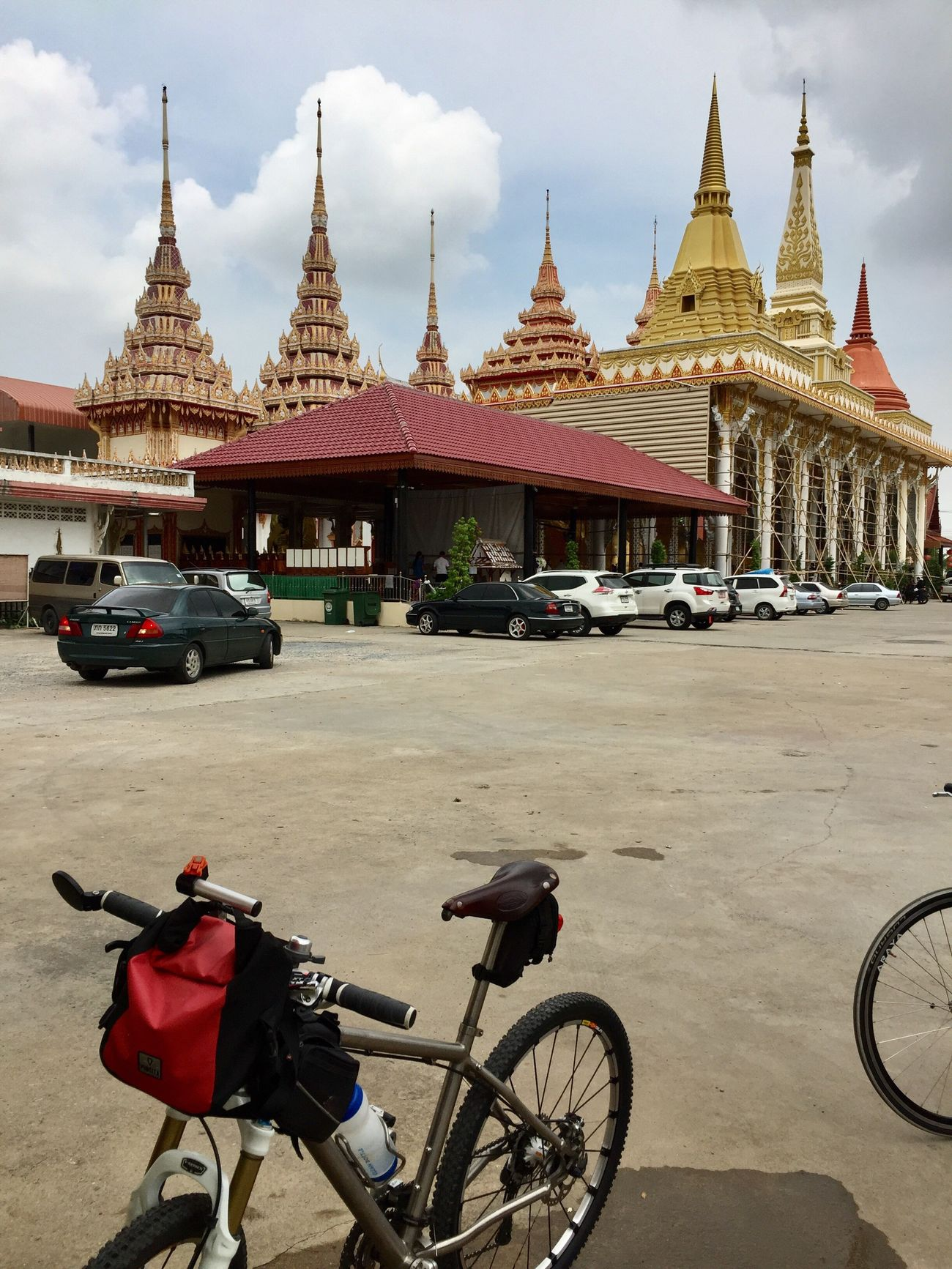 temple Built Structure Architecture Religion Real People Travel Bicycle Sky Day Outdoors Beauty In Nature Cloud - Sky Thailand