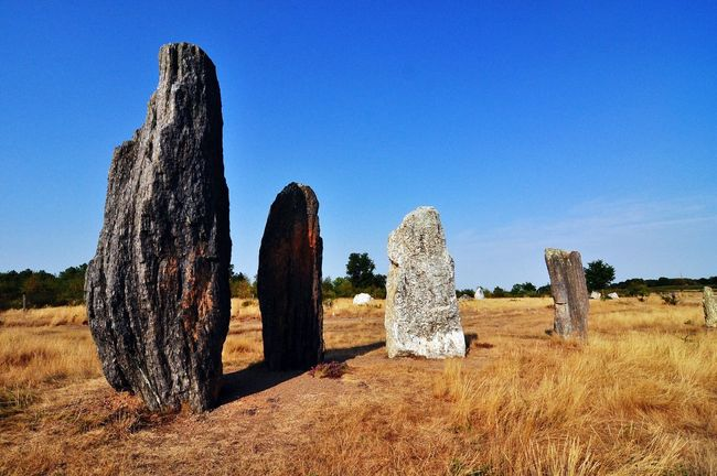 Megaliths Standing Stones Prehistoric St. Just Bretagne Brittany Tranquil Scene Outdoors In A Row Clear Sky Non-urban Scene Nature Day Solitude No People Stone Textures Field Afternoon Sunlight And Shadows