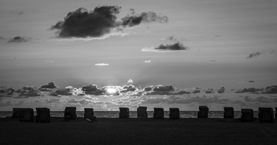 beach chairs and sunset on Amrum, Germany Amrum Black & White Copy Space Beach Beach Chairs Beauty In Nature Black And White Blackandwhite Cloud - Sky Day Germany Horizon Over Water Nature No People North Sea Outdoors Sand Scenics Sea Sky Sun Sunset Tranquil Scene Tranquility