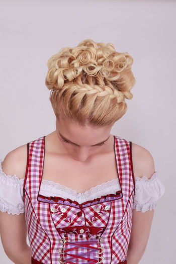 Bavarian woman in dirndl blond boy, wearing your hair braided into a French braid. View from the back of the head-Studio Shot Bavaria Bavaria Costumes Munich Oktoberfest Woman Attractive Woman Blond Hair Blonde Hair Braid Braided Day Dirndl French Braid Hairstyle Headshot Meat One Person Plaited Braid Plaited Hair Real People Standing Studio Shot Traditional White Background Young Adult