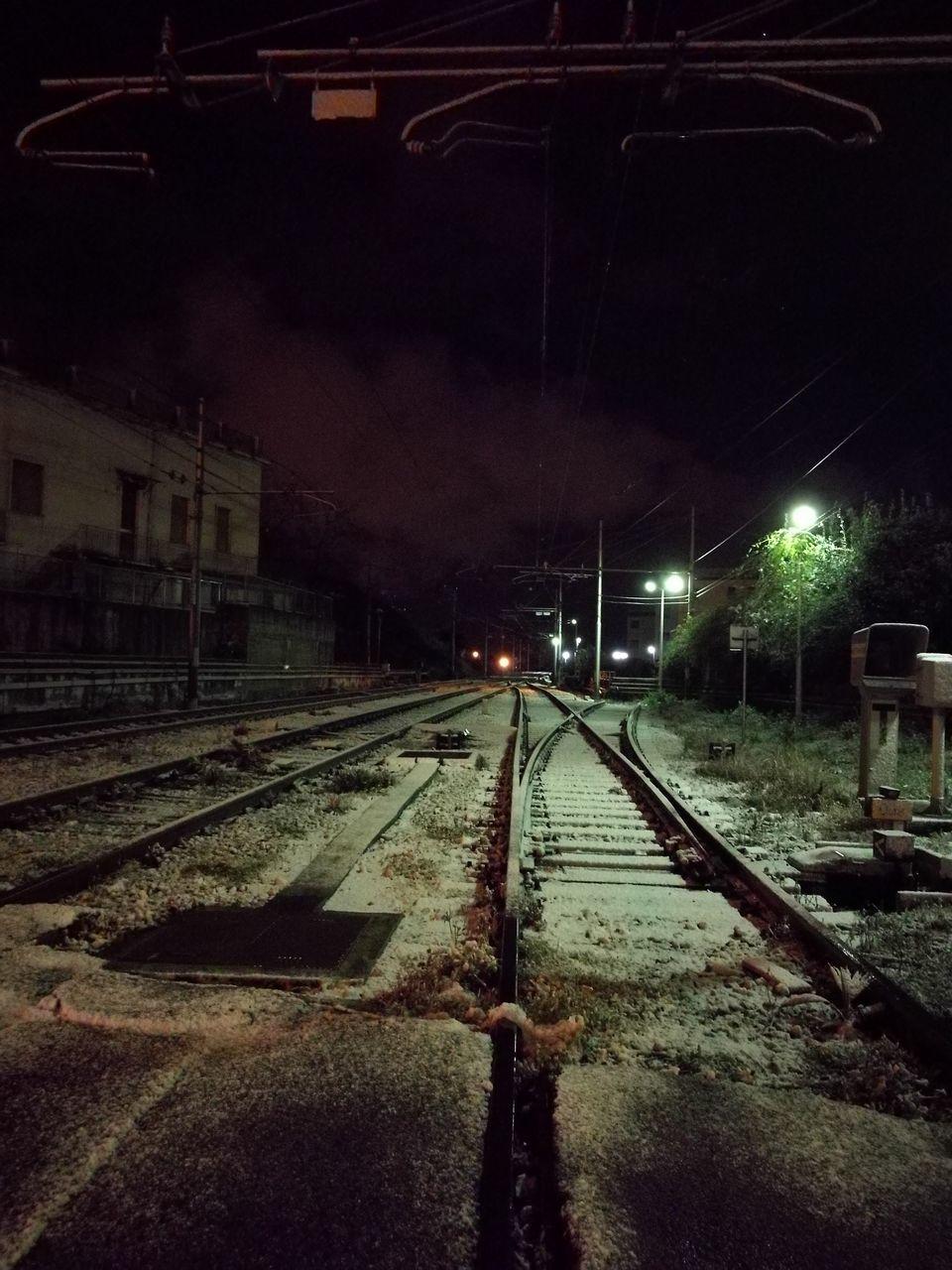 railroad track, night, transportation, rail transportation, illuminated, no people, train - vehicle, public transportation, outdoors, sky