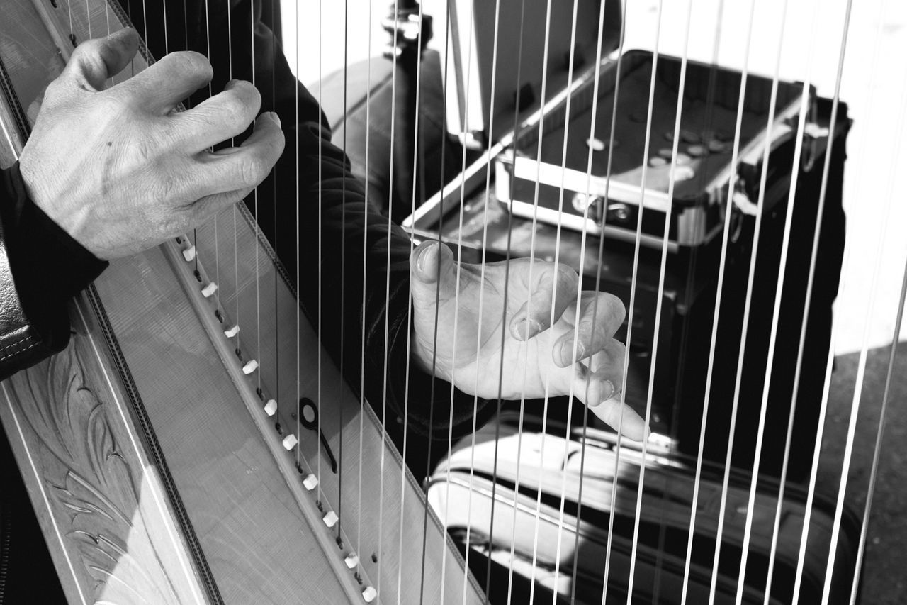 Playing Music Person Indoors  Arts Culture And Entertainment Holding Casual Clothing String Instrument Hobbies Memories Musical Instrument String Lyre Lyra Black And White Hand Hands Fingers Art Lines EyeEm Best Shots Musician Street Photography Monochrome Photography MISSIONS: The Photojournalist - 2017 EyeEm Awards The Street Photographer - 2017 EyeEm Awards