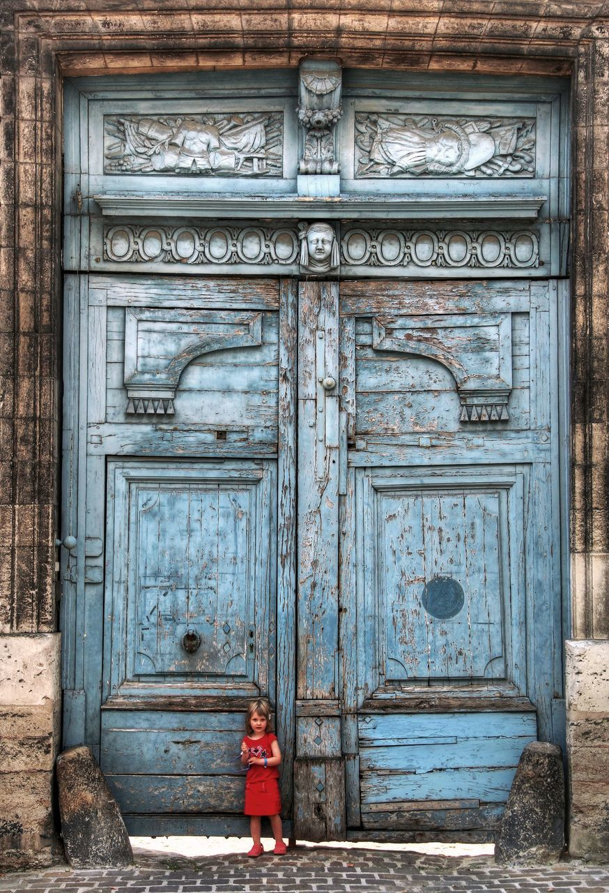 View Of Girl Against Decorated Door