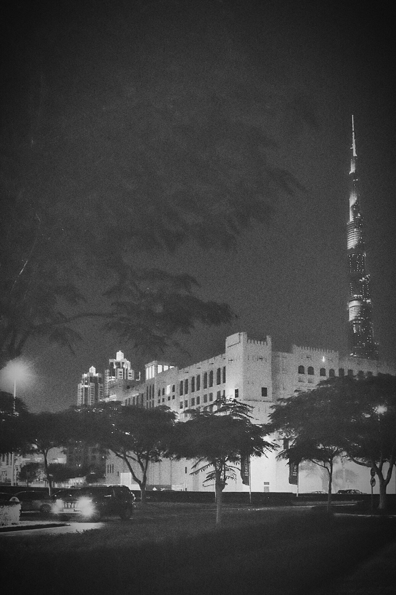 Modern noir Night No People Architecture Outdoors Black And White Street Photography City Illuminated Dubai Urban Black & White Transportation Burj Khalifa Car Vehicle Film Noir No People