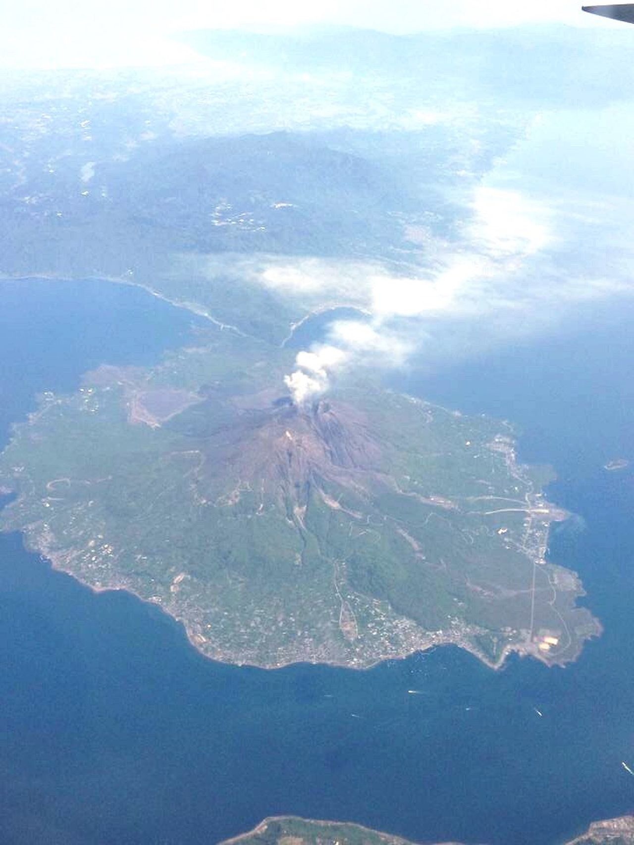 On the way back from Japan Volcano Birdeyeview Philippines Picturefromairplane Randomshot Iphone6plus Iphoneonly IPhoneography Iphonephotography Random Benzjourney Instaphoto Pictureoftheday