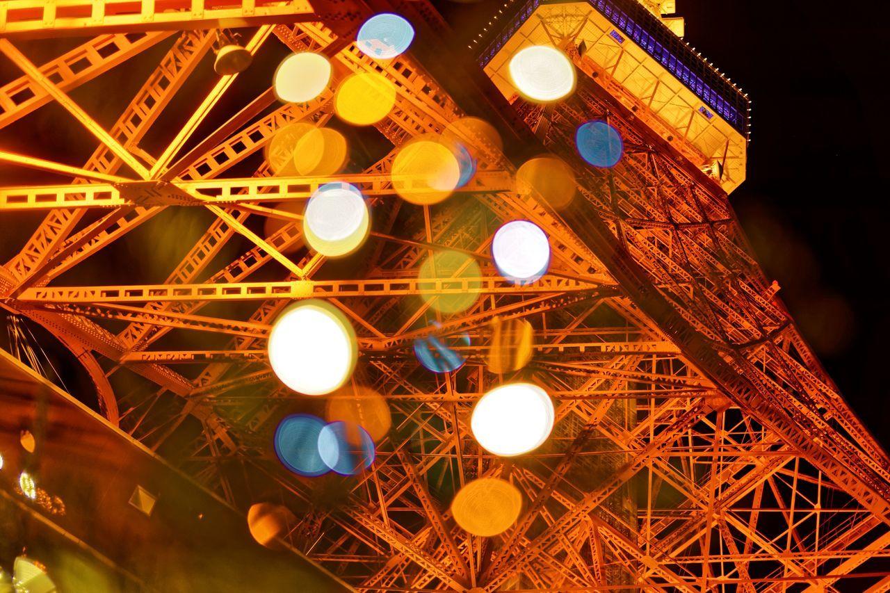 Low Angle View Of Illuminated Tokyo Tower At Night